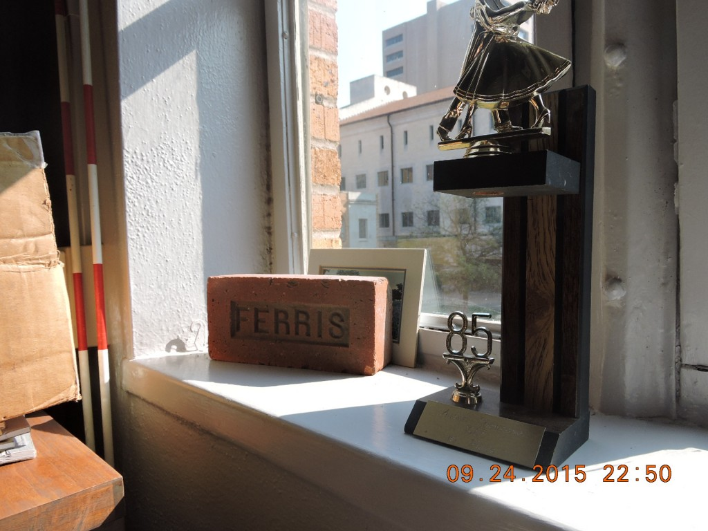 On the window sill of Ramirez's office lies a brick from the building and a trophy from 1985.