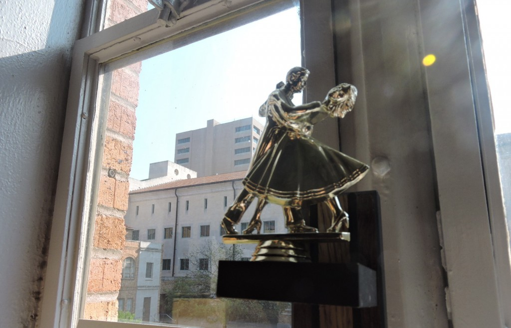 In Ramirez's office a ballroom dancing competition trophy that student participated in overlooks the courtyard from her window. Ramirez's office is Anna Hiss' original office.