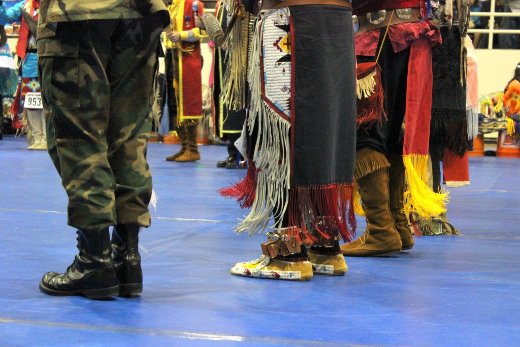 As American Indian veterans come to a circle, various American Indian representation can be seen through their attire.