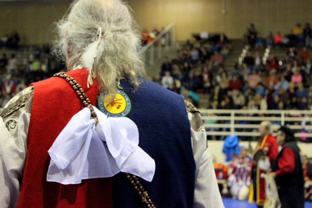 Man participating in activities during the Powwow portion honoring veterans.