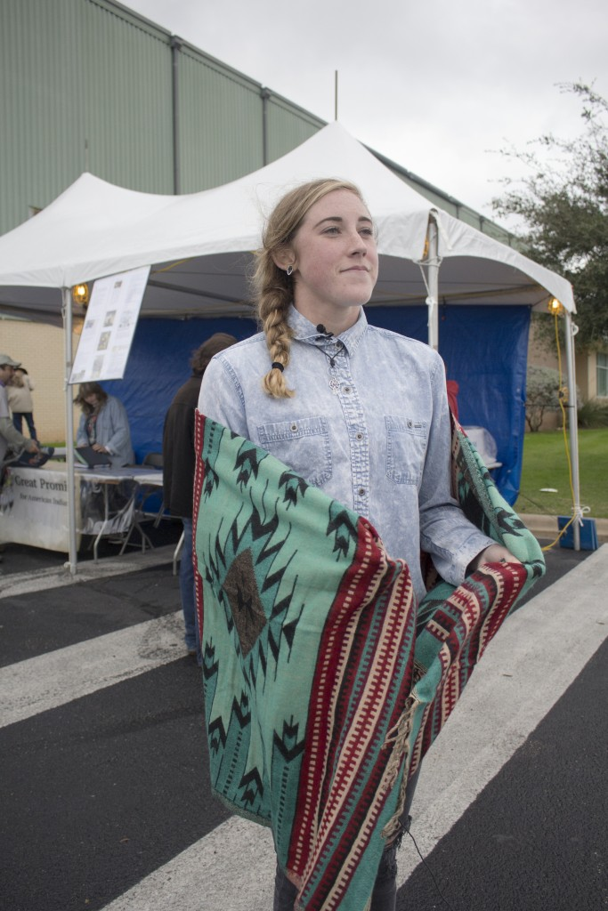 Delaney Quinn, an 18-year-old from McNeil High School, educates people on her tribe, the Western Cherokee and the American Indian Education Program.