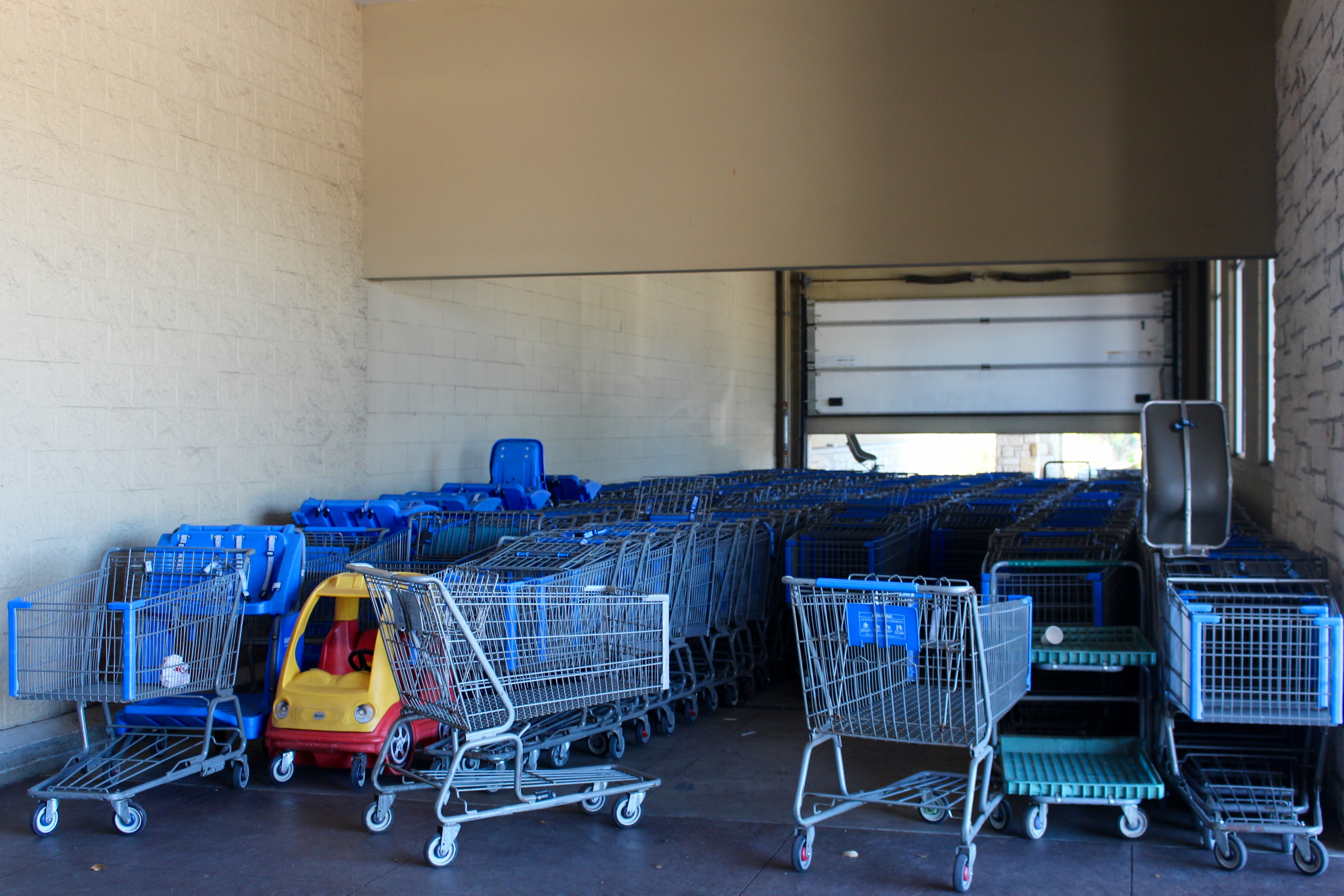 Shopping carts at closed Walmart Supercenter; Austin, Texas