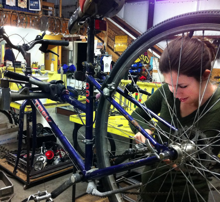 A Bikes Across Borders member working on her bicycle for the upcoming bike ride from Texas to Mexico. Photo courtesy of Bikes Across Borders.