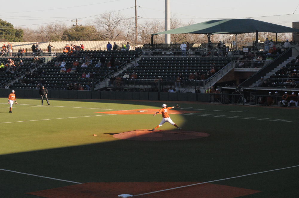 Sophomore Josh Sawyer throws a pitch in the first inning of the Texas Baseball Alumni Game. Sawyer held the alumni scoreless in four innings.