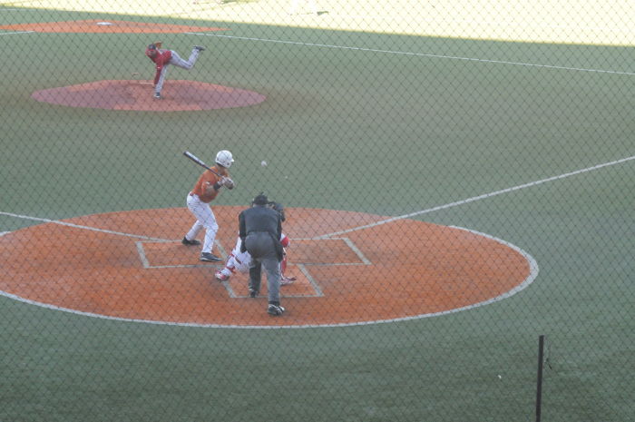 Junior catcher Tres Barerra  watches a pitch from his former Longhorn teammate, 2015 graduate Kirby Bellow. Barerra walked in the at bat.