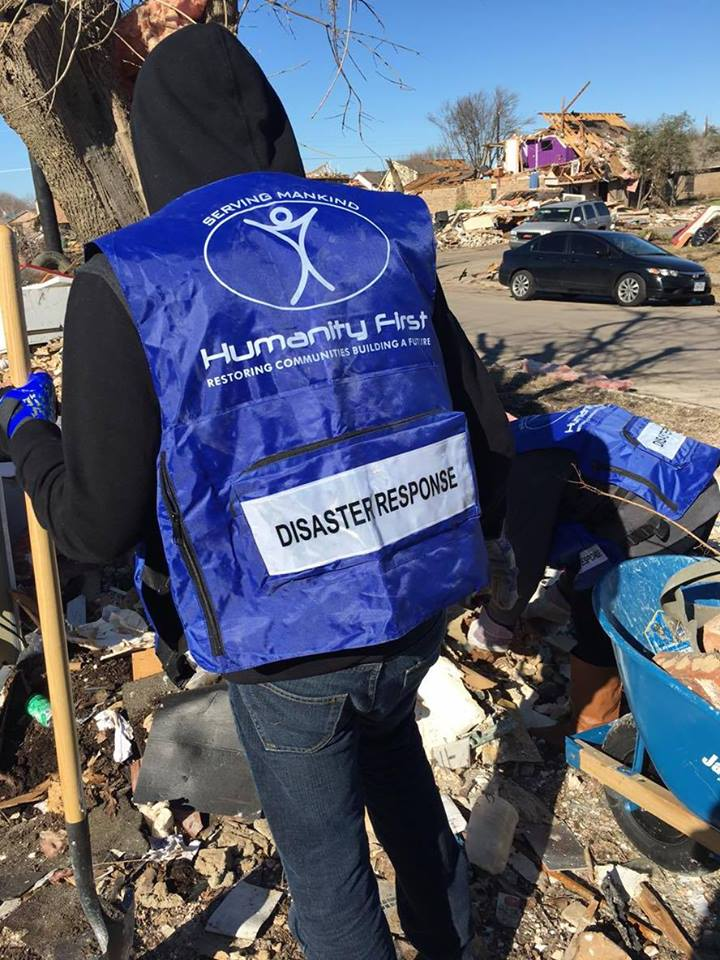 A Humanity First member working as a disaster relief volunteer.  Photo courtesy of Humanity First