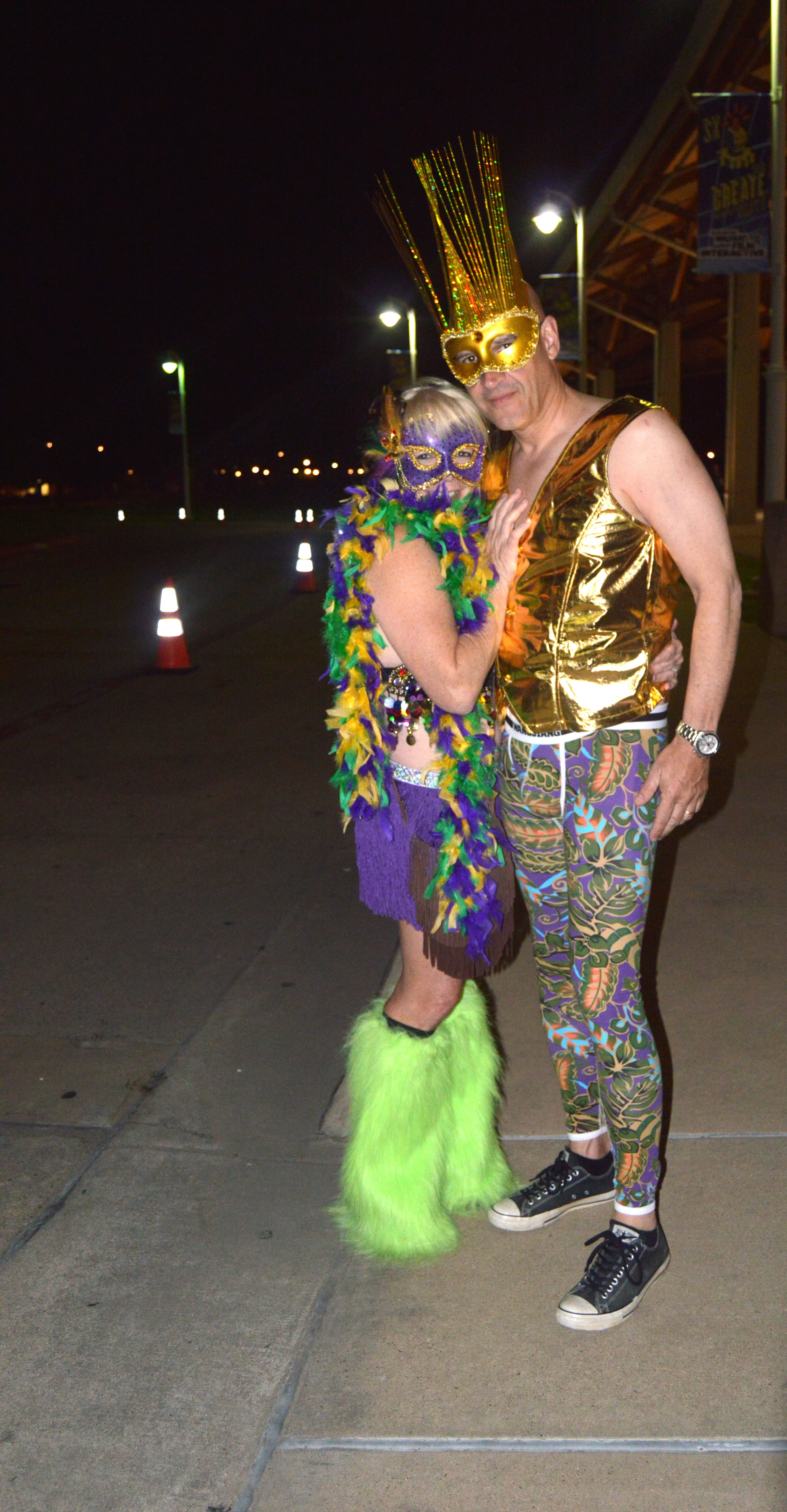 A couple dressed up in Mardi Gras themed costumes shared that this is their first time at Austin's Carnaval celebration.