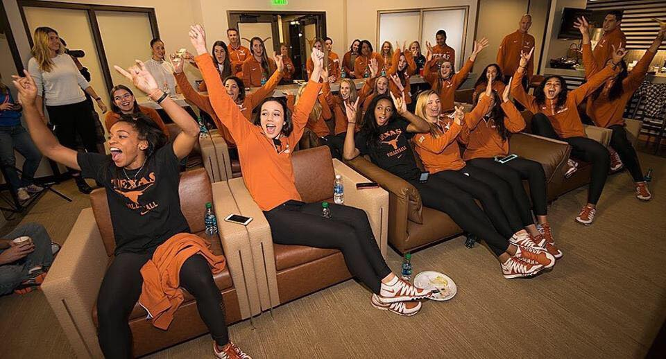 Chloe Collins, a setter for Texas Volleyball, rejoices with teammates before watching a film.