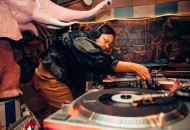 """Chulita Vinyl Club team lead and DJ Xochi Solis focuses on the turntable at the collective's gig Feb. 24 at the Carousel Lounge. The """"all-girl all-vinyl"""" group of DJs is based in Austin and has chapters in San Antonio and on the West Coast."""