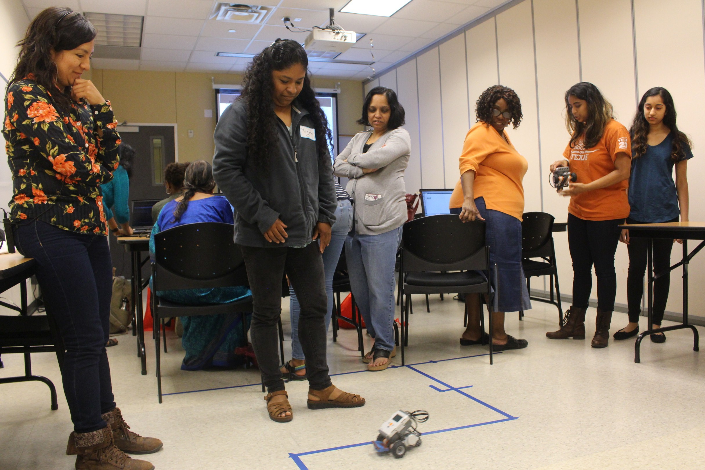 At the Mind the Bot workshop Marlene test her robot's path programming in front of her peers.