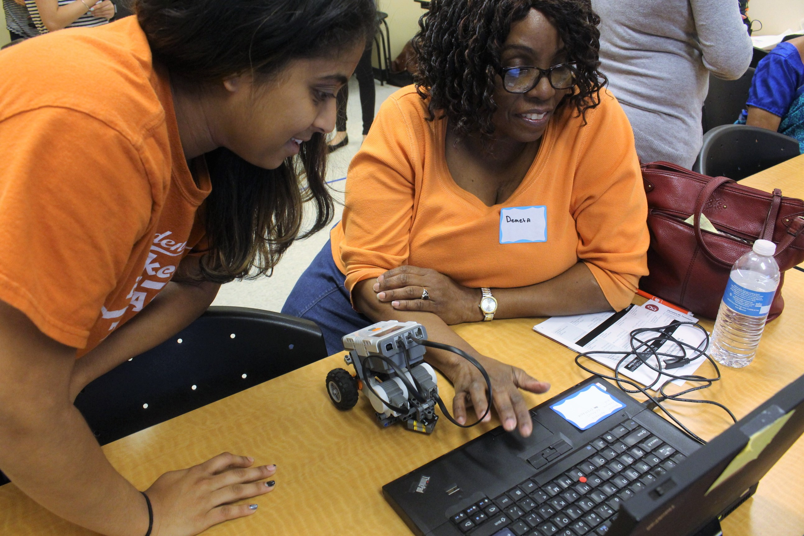 Demeta is taught how to program her robot at the Mind the Bot workshop.