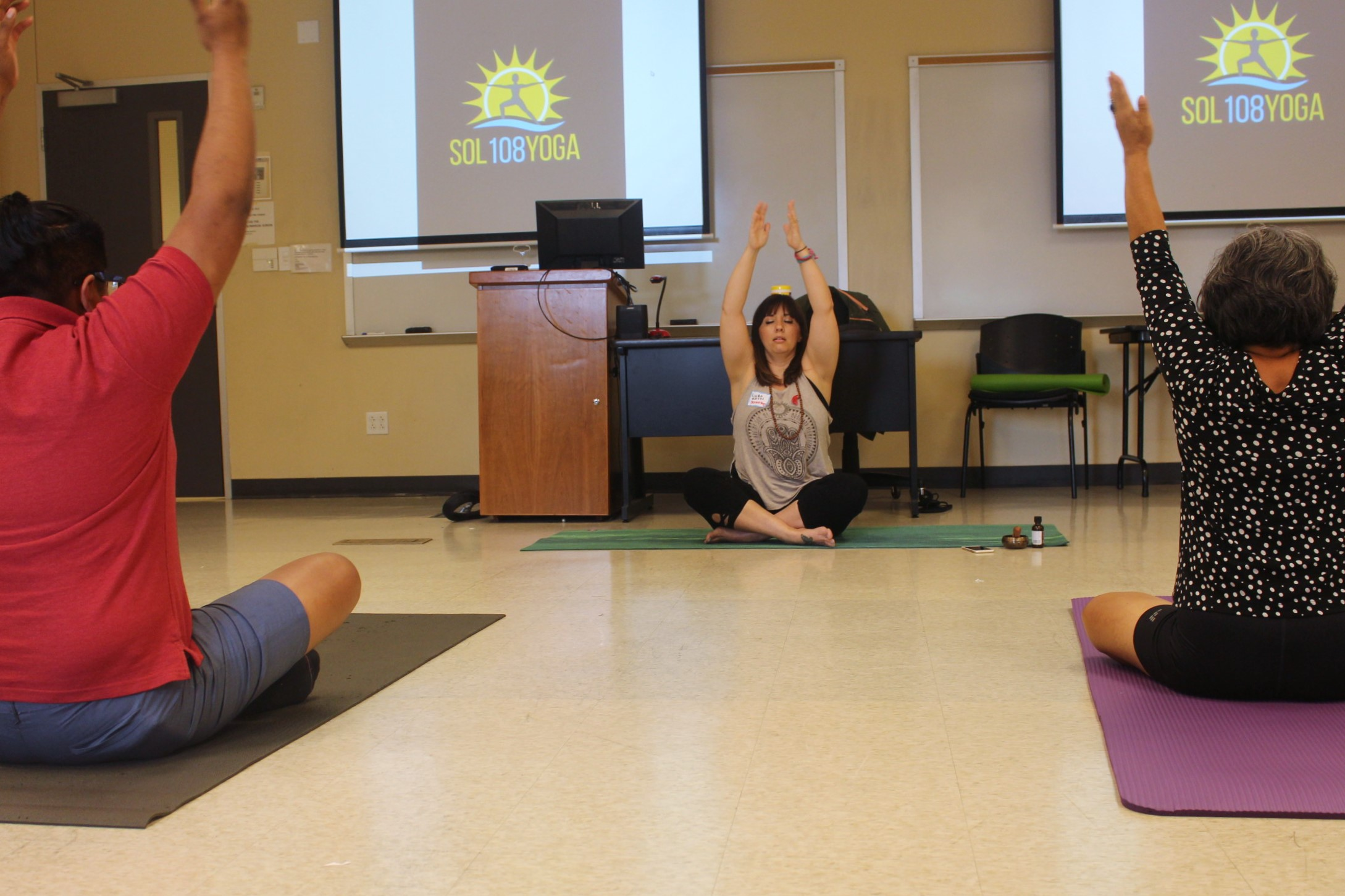 Linda Natera from Sol108Yoga teaches the practice of Hatha Yoga to students at the Bilingual Yoga workshop.