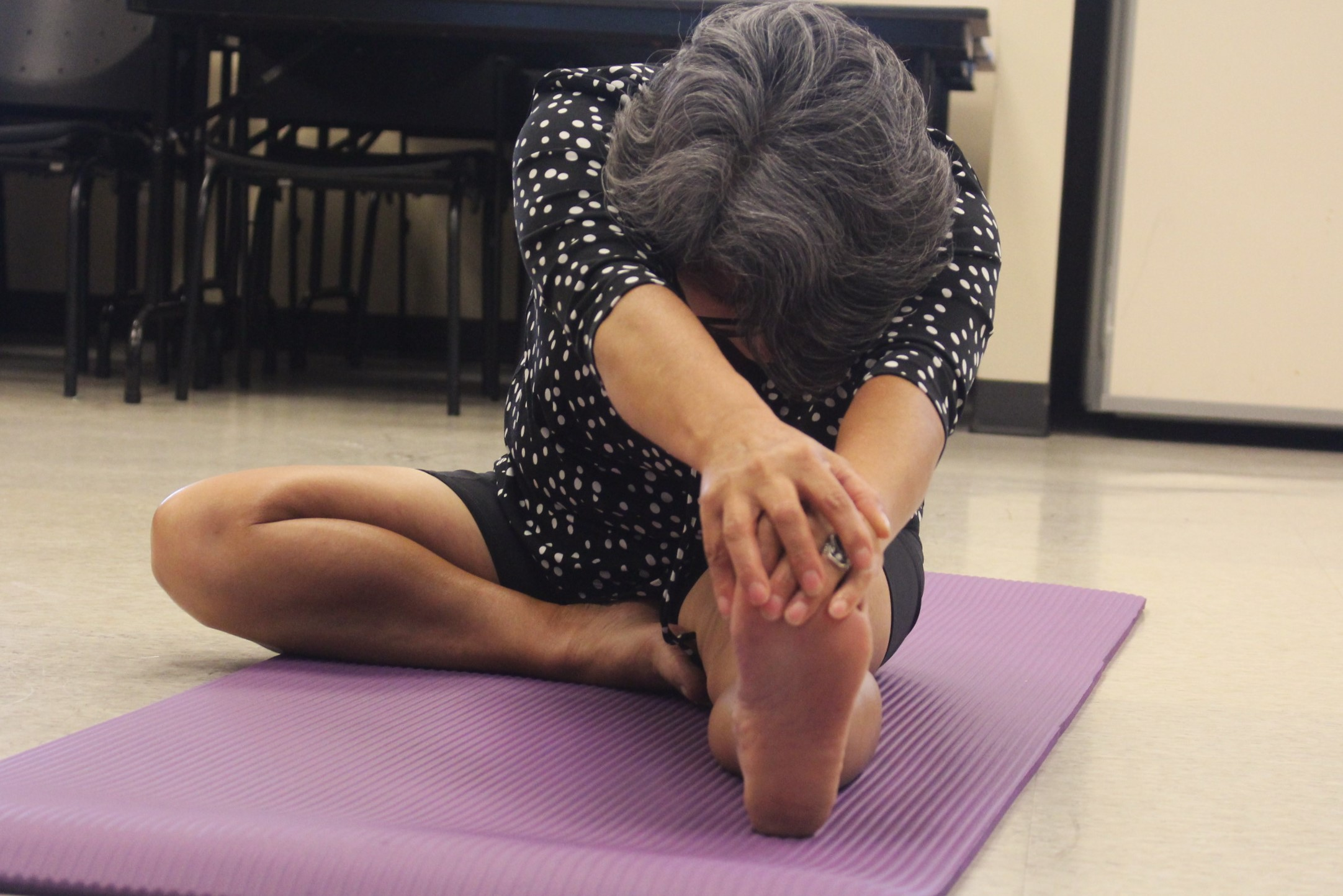 A student practices Hatha Yoga at the Bilingual Yoga workshop.