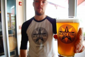 Andy Martinec, head brew master, with Black Star Co-op's house IPA.  Photo: Black Star Co-Op/Facebook