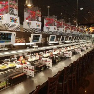 Each seat has access to the two levels of the conveyor belt, the ordering panel and the Bikkura Pon game.  Photo: Kula Revolving Sushi Bar/Facebook